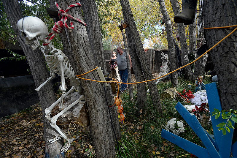 Actors Angela Helburg, left, and Gene Fleming walk through the trees Wednesday, Oct. 11, 2017, at Creepy Walk in the Woods, 1750 Savage Rd, in Loveland. 9Photo by Jenny Sparks/Loveland Reporter-Herald)