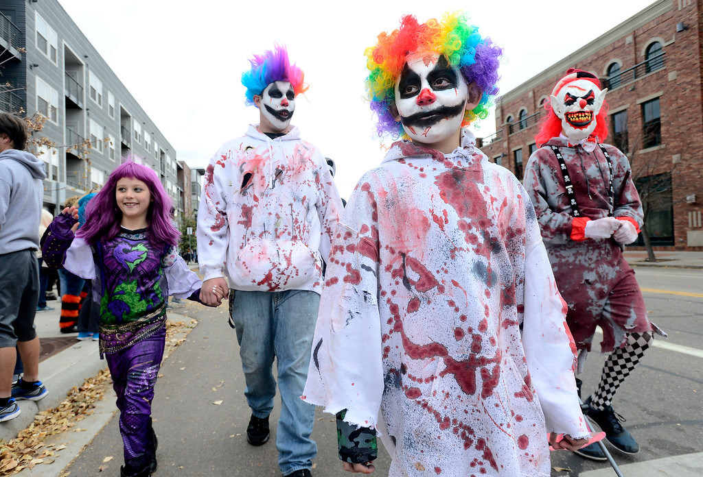 . From left to right Emilee Edwards, Justin Dobbins and Spencer and Jeremy Edwards march during the Halloween Parade in Longmont on Saturday. For more photos and video go to timescall.com Paul Aiken Staff Photographer Oct 28 2017
