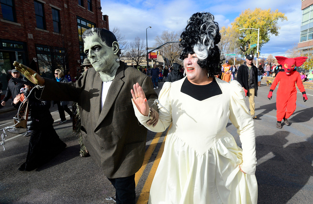 . Ron and Veronica Quintana dress up as Frankenstein and his Bride during the Halloween Parade in Longmont on Saturday. For more photos and video go to timescall.com Paul Aiken Staff Photographer Oct 28 2017