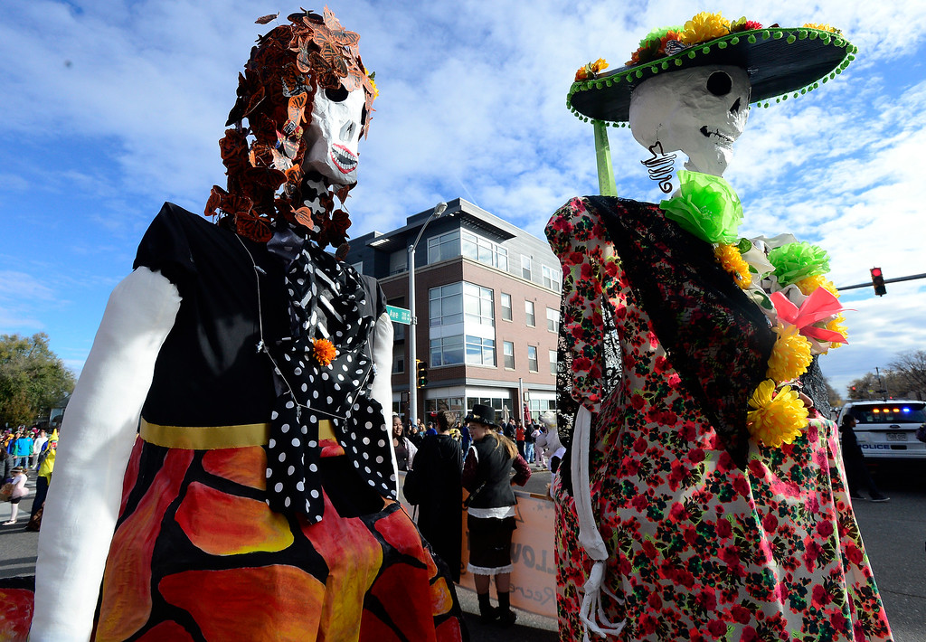 . Paula Fitzgerald and Stephaniz Hilvitz dress up as Gigantes Day of the Dead characters during the Halloween Parade in Longmont on Saturday. For more photos and video go to timescall.com Paul Aiken Staff Photographer Oct 28 2017