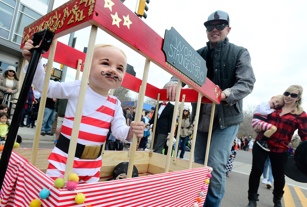 . Lincoln Morrow rolls down Main Street with the help of his dad Dustin during the Halloween Parade in Longmont on Saturday. For more photos and video go to timescall.com Paul Aiken Staff Photographer Oct 28 2017