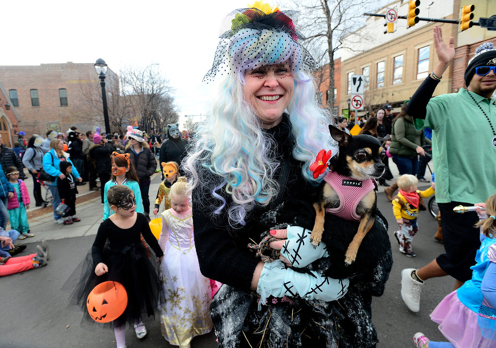 . Ginger Tatic with her dog Penelope during the Halloween Parade in Longmont on Saturday. For more photos and video go to timescall.com Paul Aiken Staff Photographer Oct 28 2017