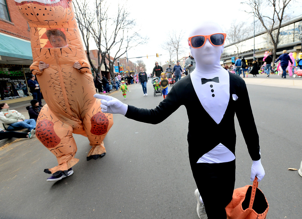 . Caden Grestini dressed as Slender Man during the Halloween Parade in Longmont on Saturday. For more photos and video go to timescall.com Paul Aiken Staff Photographer Oct 28 2017