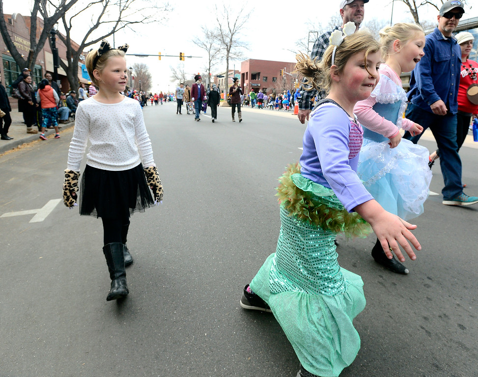 . From left to right Holly Whitmore, Leah Robinson and Harper Whitmore dance down the street during the Halloween Parade in Longmont on Saturday. For more photos and video go to timescall.com Paul Aiken Staff Photographer Oct 28 2017