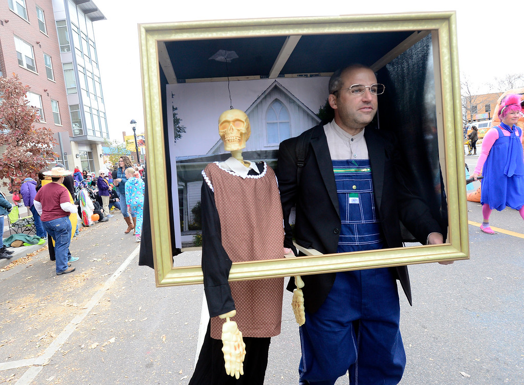 . Scott Conlin and his American Gothic costume during the Halloween Parade in Longmont on Saturday. For more photos and video go to timescall.com Paul Aiken Staff Photographer Oct 28 2017