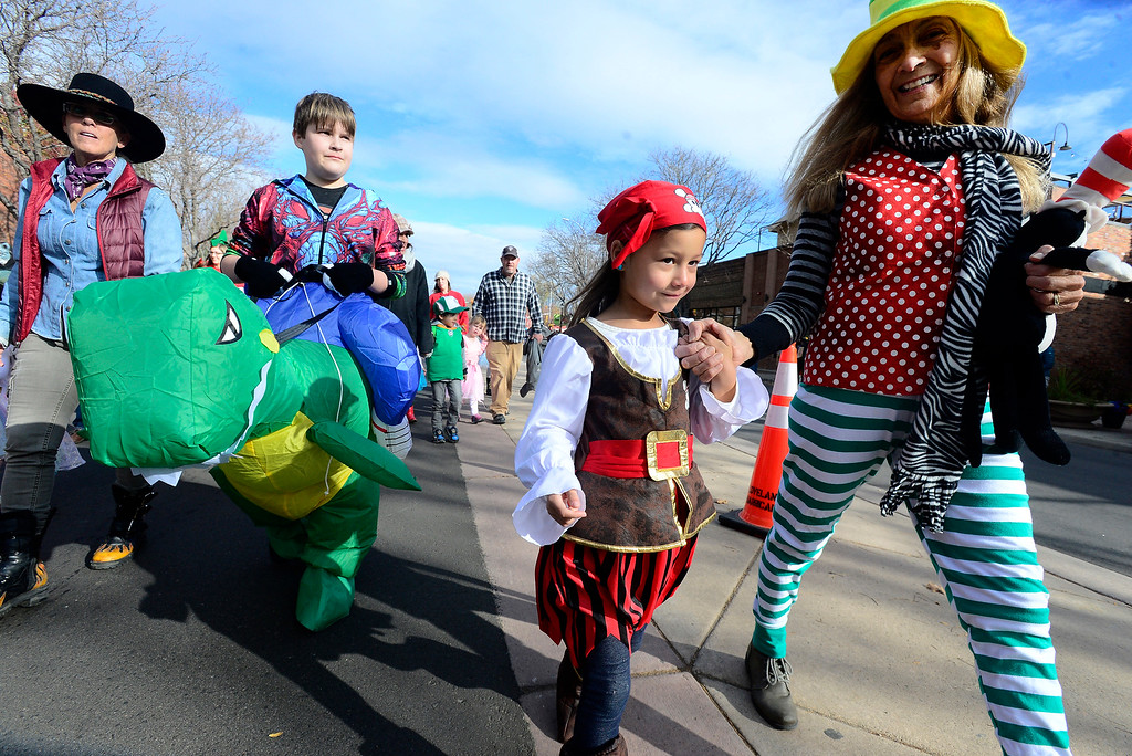 . Peyton and Mackenzie Portfolio get escorted down the parade by their grandmother Stephanie Portfolio, at Portfolio during the Halloween Parade in Longmont on Saturday. For more photos and video go to timescall.com Paul Aiken Staff Photographer Oct 28 2017