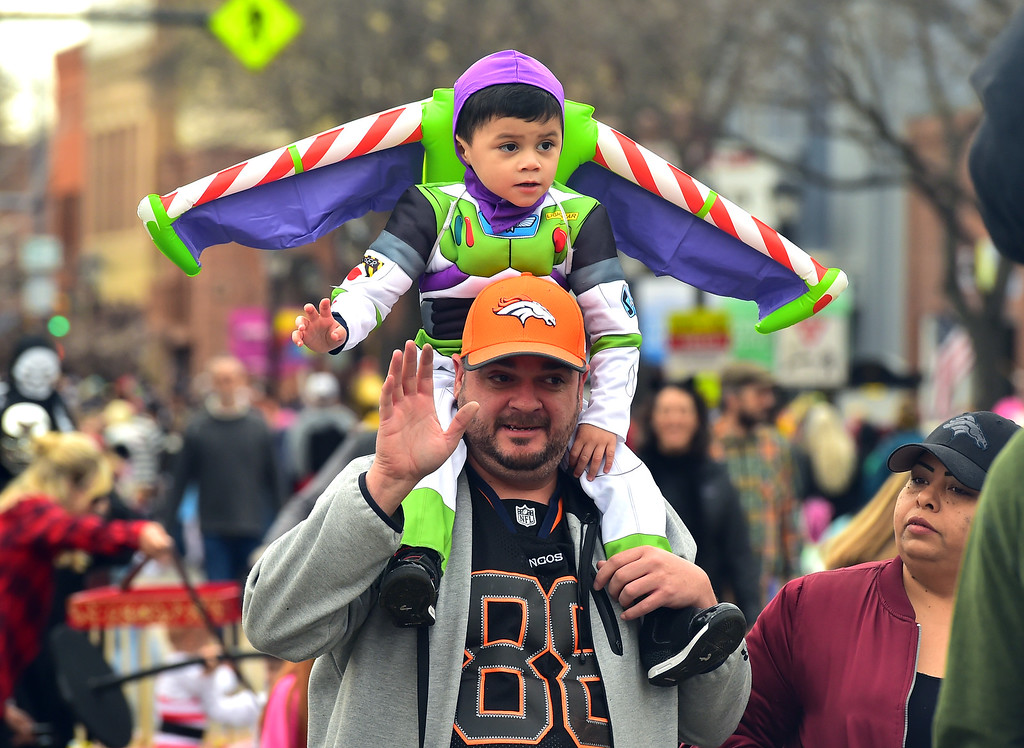 . Robert Stevens, 3 rides the shoulders of his grandfather Lorenzo Herrera during the Halloween Parade in Longmont on Saturday. For more photos and video go to timescall.com Paul Aiken Staff Photographer Oct 28 2017