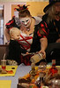 HOLLY PELCZYNSKI - BENNINGTON BANNER Niya Perkins, 18 mo of Bennington paints a Halloween craft with the help of nurses aid Jessica Sweeney on Wednesday afternoon during a Halloween party and celebration held at Crescent Manor nursing home in Bennington.