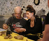 HOLLY PELCZYNSKI - BENNINGTON BANNER Staff member Stephanie Sacilowski helps patient, Harold Cross with a craft on Wednesday afternoon during a Halloween party held at Crescent Manor Nursing Home in Bennington.