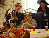 HOLLY PELCZYNSKI - BENNINGTON BANNER Resident Candy Patients gets some help with a craft from nurses aid Jen Gardener on Wednesday afternoon at Crescent Manor Nursing Home in Bennington during their Halloween Party celebration.