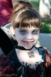 5-year-old Caitlin Daily of Chico smiles in her vampire costume as she gets candy in downtown Chico during Treat Street Thursday Oct. 31, 2013. (Bill Husa/Staff Photo)