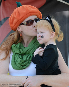 Mary Johnson gives Cherylise Johnson, 2, a kiss Saturday, Oct. 31, 2015, during Treat Street in downtown Chico, California. (Dan Reidel -- Enterprise-Record)