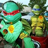 Gabriel Martin(3, Rafael, teenage mutant ninja turtle), Seth Martin(5, Donatello) andSage Martin get a ride in a wagon as they get treats downtown treat street Friday afternoon on Main St.<br /> photo by Glenn Fuentes<br /> news<br /> 10/31/03