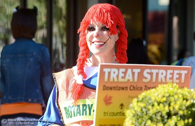 Rotarian Sally Shelton smiles in her Raggedy Anne costume as she helps people cross the street in downtown Chico during Treat Street Thursday Oct. 31, 2013. (Bill Husa/Staff Photo)