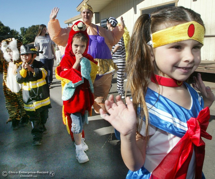 "Costume parade at Jay Partridge School thursday afternoon. Rachel Klingerman 5 years old in her ""Sailormoon"" costume waves at older students as she struts her stuff during the school wide parade. The kid behind her in red is Hannah Craig and the lady is Cheryl Byers a mother of a student at the school. ty news 10/30/03"