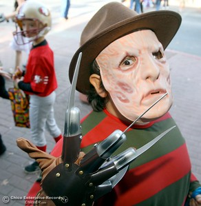 9-year-old Liam Burke of Chico enjoys his Freddy Kurger costume during the 12th annual Treat Street Halloween celebration in dowtown Chico CA Monday, Oct. 31, 2011. (Bill Husa/Chico Enterprise-Record)