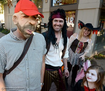 Carl Holmquist at left says he doesn't really smoke even though his costume does as he walks with members of the  Lundstam family from Malmo, Sweden as they enjoy Treat Street in downtown Chico, Calif. Thursday Oct. 31, 2013. (Bill Husa/Staff Photo)