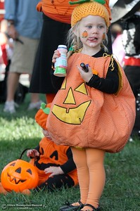 2-year-old pumpkin Livia Cioban of Chico enjoys something to drink as her family gets ready for the costume contest during the 12th annual Treat Street Halloween celebration in dowtown Chico CA Monday, Oct. 31, 2011. (Bill Husa/Chico Enterprise-Record)