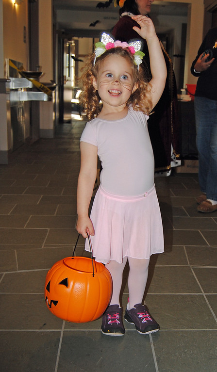 . NASHOBA VALLEY VOICE/ANNE O\'CONNOR The folks working in and around the town offices in Shirley decided to celebrate Halloween with the community. Viviana Steinberg, 3, came as a ballerina.