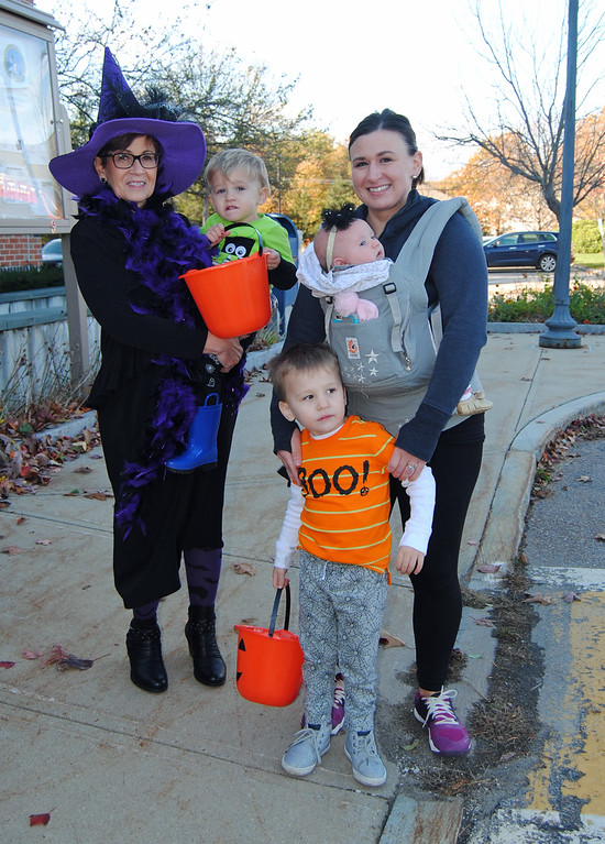 . NASHOBA VALLEY VOICE/ANNE O\'CONNOR The folks working in and around the town offices in Shirley decided to celebrate Halloween with the community. Sandi Hill holds holds grandson Sal Strazzullo, 2. Dominic, 3, and baby Gina, 3-months-old are with their mom Melissa Srazzullo.