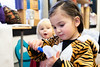 Avery Blesofsky draws a face on her finger puppet (while Little Red Riding Hood looks on) at Windham Movement Apparel during BrattleBOO, Brattleboro's Halloween festivities.  KELLY FLETCHER, REFORMER CORRESPONDENT
