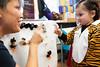 Stephanie & Avery Blesofsky make finger puppets at Windham Movement Apparel during BrattleBOO, Brattleboro's Halloween festivities.  KELLY FLETCHER, REFORMER CORRESPONDENT