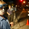 A spooky looking Chris Larabee of Chico looks over his shoulder along Main Street in Chico early Thursday night while NCN reporter Maureen Naylor does her broadcast with NCN Photographer Jay Lang. Husa foto