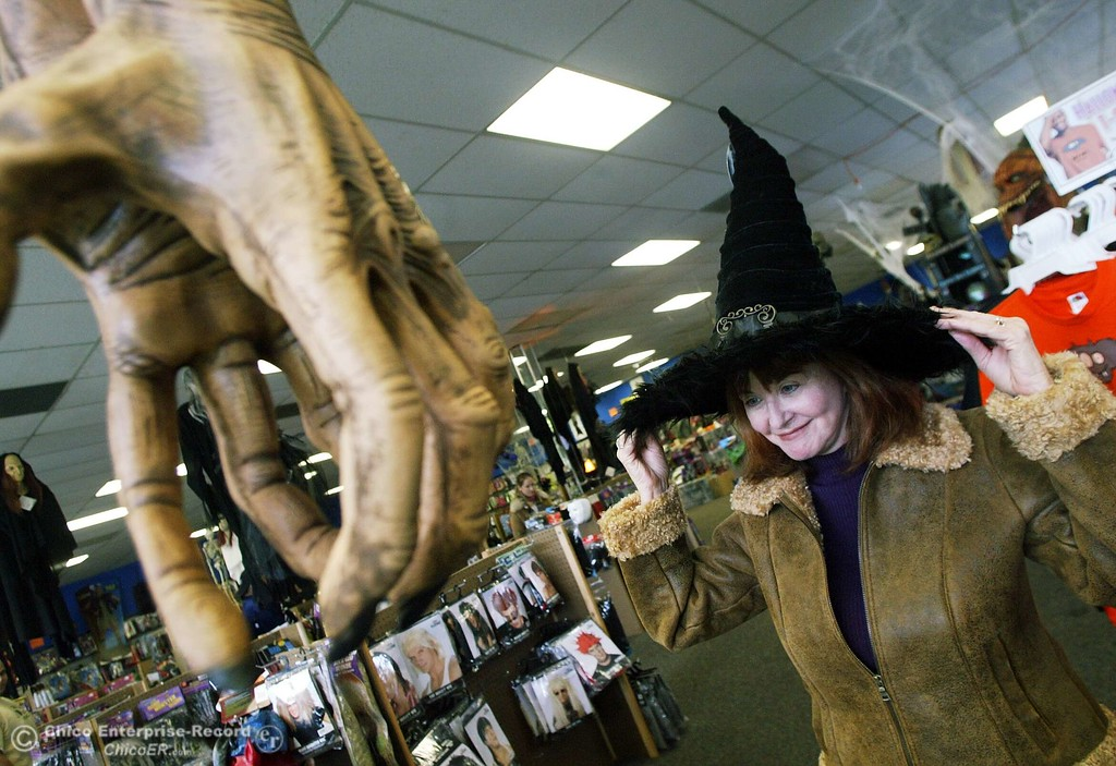 susan adams tries on a witchs hat as she is going