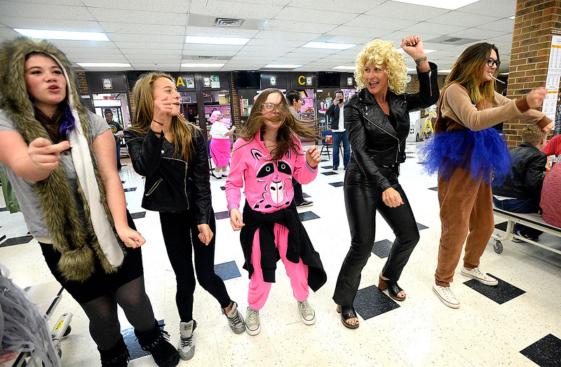 "Walt Clark Middle School resource officer Bobbie Jo Pastecki, dresses as Sandy from ""Grease"", dances to Greased Lightning Tuesday, Oct. 31, 2017, with students during lunch at the school in Loveland. Staff at the school dressed as characters from the movie and did a flash mob style dance during lunch for Halloween. Students from left are Simone Chandler, 13, Alyssa Paulson, 12, Brooklyn Roath, 12, and Teale Viegut, 13.   (Photo by Jenny Sparks/Loveland Reporter-Herald)"