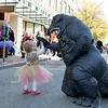 Main Street in Fitchburg was closed down on Saturday for the annual Halloween on Main Street event. Juliana Coolen, 2, of Fitchburg high fives Godzilla during the event. SENTINEL & ENTERPRISE/JOHN LOVE