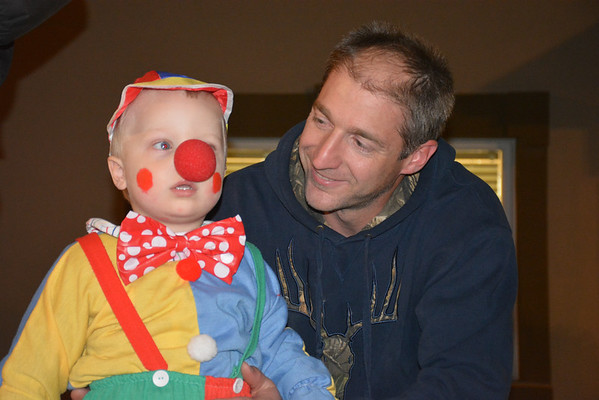 Noah Friese participates in the Halloween celebration at Strasburg Oct. 26, as dad Brock looks on.