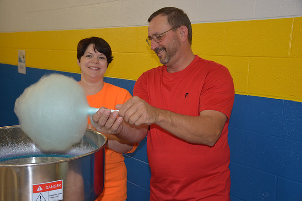 Sarah Wright and Stan Salmon of St. Elmo whip up some cotton candy during the Halloween Festival at Altamont Lutheran Interparish School Oct. 26.