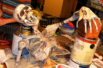 Adding paper mache.  Detailed instructions can be found here:  http://seasonofshadows.com/home.htm and http://spookyblue.com/