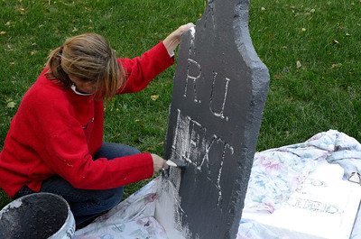 "We made several new tombstones this year.  After carving and ""weathering"" the tombstones with a soldering iron, we painted them with ""monster mud.""  Detailed instructions can be found here: http://www.youtube.com/watch?v=bXXvKNqJX_0"