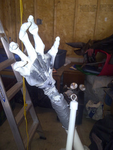I put romex in a skeleton glove and duct taped it to the end of the arms.