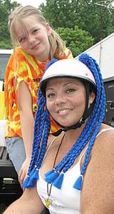 Ms. Kimber herself, braiding away at FACES Ride 4 Smiles.
