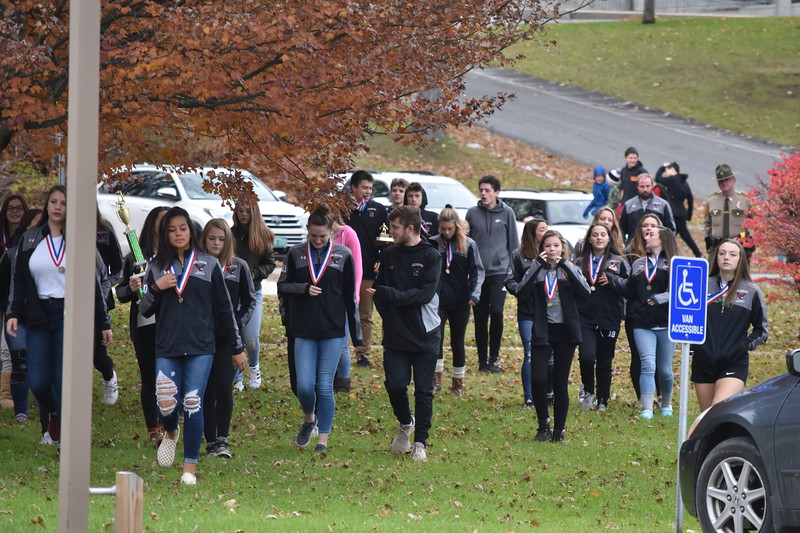 "GREG SUKIENNIK  --  MANCHESTER JOURNAL<br /> The Arlington Memorial High School girls and boys soccer teams walk towards Fisher Elementary School., where students and teachers honored them with a ""Hallway Hooray"" on Monday for winning the state Division 4 soccer titles."