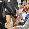 "GREG SUKIENNIK  -- MANCHESTER JOURNAL<br /> As the Arlington Memorial High School girls and boys' soccer teams made their way through a ""Hallway Hooray"" on Monday morning at Fisher Elementary School, they slapped five with teachers and students alike."