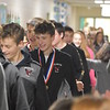 "GREG SUKIENNIK  -- MANCHESTER JOURNAL<br /> Students and teachers at Fisher Elementary School applaud the state champion Arlington Memorial High School girls and boys' soccer teams during a ""Hallway Hooray"" on Monday morning."