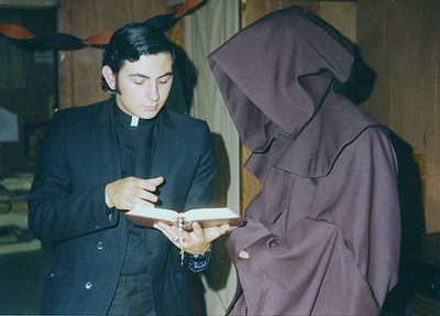 Priest (Dave) compares notes with Monk (Bill McK.)