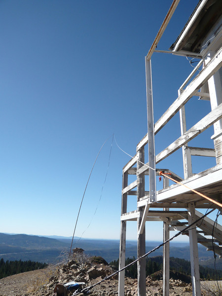 My mast, antenna and twinlead feedline as seen from next to the lookout tower. The camera is looking south.