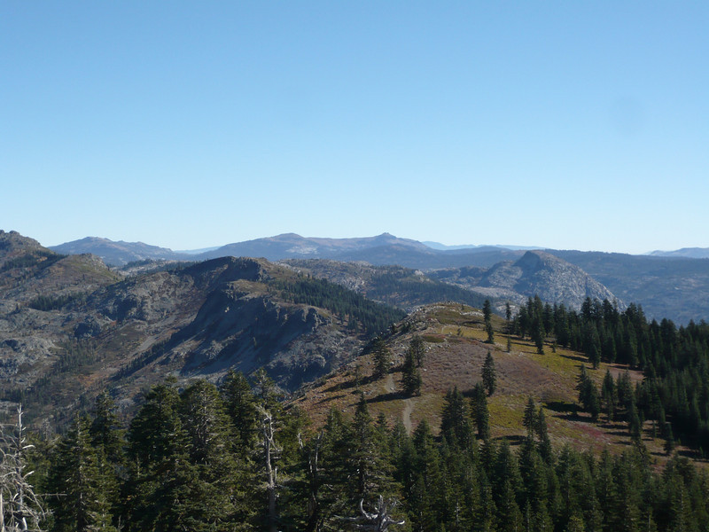 """To the east, Old Man Mountain (W6/NS-184) is the half-dome-shaped mountain approximately 1/3 of the way from the right edge of the photo. The Fordyce Creek 4x4 trail runs along the base of it as it follows Fordyce Creek from I-80 near Cisco Grove up to Meadow Lake. <a href=""""http://www.grizzlyguy.com/HamRadio/SOTA-Activation-942012-Sand"""">Sand Ridge</a>, Castle Peak and various other SOTA summits are back toward the skyline. Part of the <a href=""""http://www.grizzlyguy.com/HamRadio/SOTA-BlackButtes-W6NS270-2013"""">Black Buttes (W6/NS-170)</a> is visible along the left edge of the photo."""