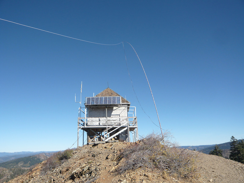 I had planned to setup my 28' Jackite pole mast next to the lookout tower, but the the ridge drops off steeply past the tower and there wouldn't have been room to tie off that end of my 88' doublet. I instead anchored the bottom of the mast in a bush midway down the short ridge top. The camera is looking north.