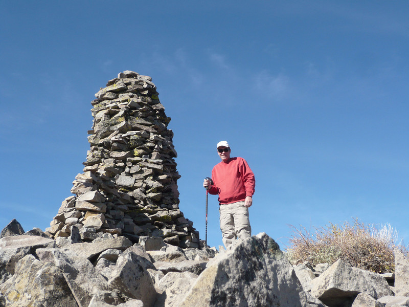 Standing on top next to the massive cairn that marks the summit.