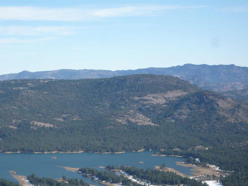 """To the east-northeast across Lake Davis is <a href=""""http://www.grizzlyguy.com/HamRadio/SOTA-Activations-W6CN005-NS207"""">Crocker Mountain (W6/NS-207)</a>. The road up to it climbs up a canyon on the north-facing side, so it probably has a lot of snow on it and may be impassable."""