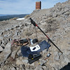 My operating position. I ran the twinlead down to my hiking pole and through its wrist strap so as to keep the twinlead off the ground. The twinlead runs into a Balun Designs 4:1 QRP balun (under the rock) and a 1-foot long RG-58 coax jumper connects it to the KX3. With this setup, one quick tap on the KX3's ATU button gets me on any band from 6m to 80m.