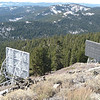 I don't know what these things are. They are on the west slope of the mountain just a short distance down from the top. When I saw the first one, I thought it might be a passive reflector for a microwave link, but I have no idea why they would have two of them pointed at each other.