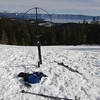 I quickly set up my ALexLoop and Buddipole Shockcord mast. There was nothing to secure the mast to, so I stuck my ski firmly down into the snow and secured the mast to the tip of my ski using a bungee cord. The snow was firm enough that it made for a rock-solid mount. That's Lake Tahoe in the background and I am set up right on the edge of the ski area (hence the untracked snow beyond this point).