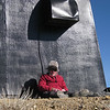 The wind was cold! I've got my fur-lined Elmer Fudd hat on over my NCCC cap and mini headphones. Do I look goofy or what? And no, I'm not diddling with myself, I'm ditting and dahing Morse code using the mini keyer paddles that are in my hands. <br /> <br /> Unfortunately the FAA guys weren't up there to test the building's air conditioning system. Warm exhaust air blowing down onto my head would have been sweet!