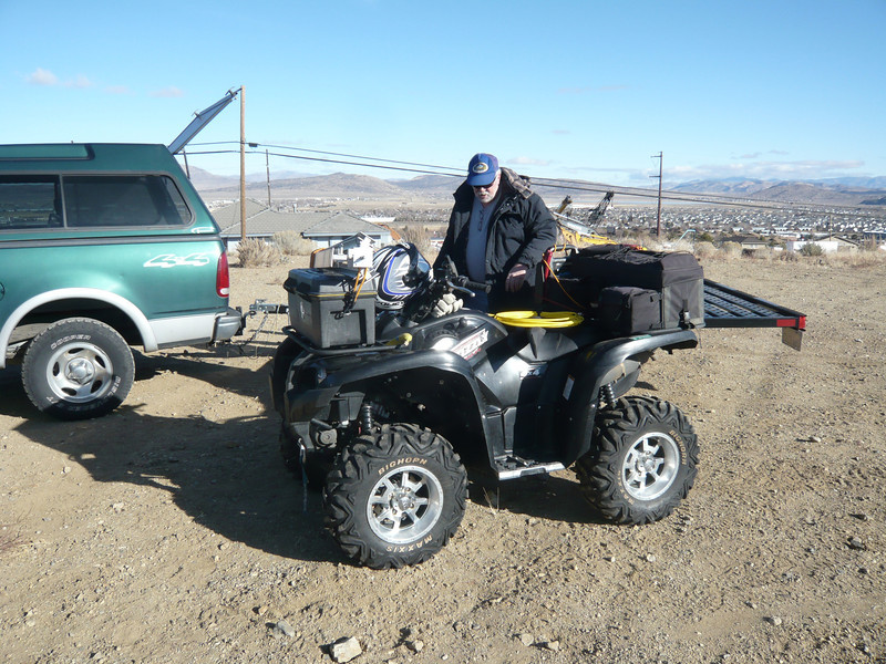 "Dave, K6MTT loading his Grizzly for our trip up to the peak. ""Let's see, I've got my battery, antenna, helmet, coax (bright yellow)... but where'd that radio go?"""